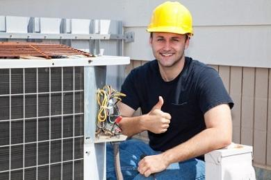 photo of an air conditioning service technician working on an air conditioning unit
